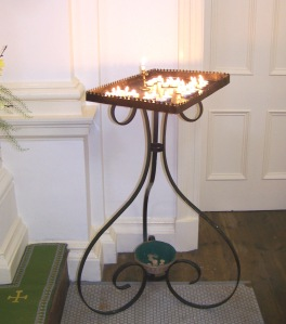 Our beautiful wrought iron candle tray.  Parishioners dedicate candles for special intentions.