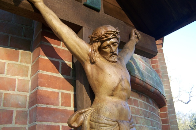 Detail of the crucifix, showing the lifelike quality of the carving.