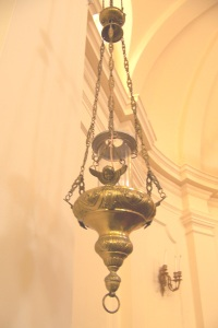 Our brass Sanctuary Lamp, which is lit to signify the presence of the Holy Sacrament.